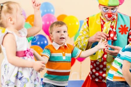 joyful kids with clown on birthday party Stock Photo - 15583479