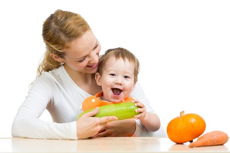 baby eating: Mother with baby  baby at table  Boy holding zucchini