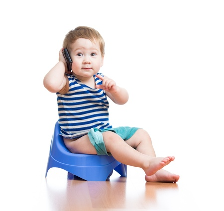 funny baby sitting on chamber pot and listening pda photo