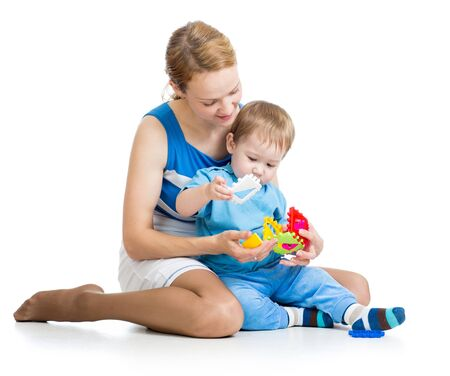 baby boy and mother playing together with puzzle toy Stock Photo - 15586202