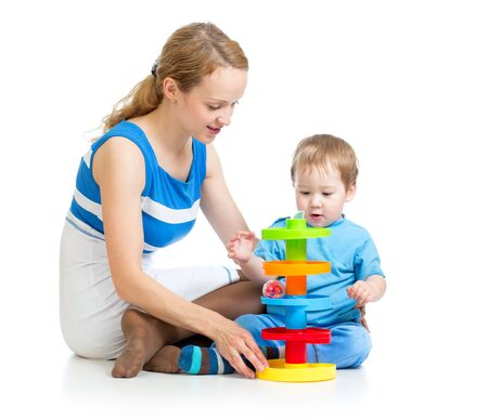 baby boy and mother playing together with puzzle toy photo