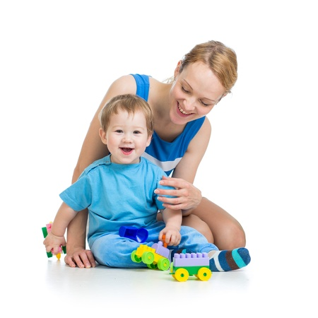 baby boy and mother playing together with construction set toy Stock Photo - 15586183