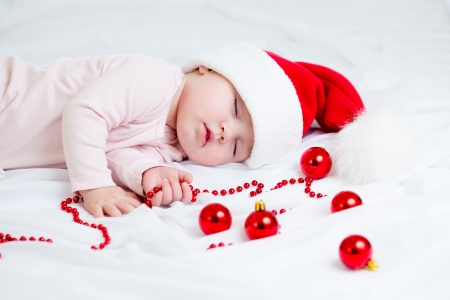 christmas baby: sleeping baby girl Santa Claus