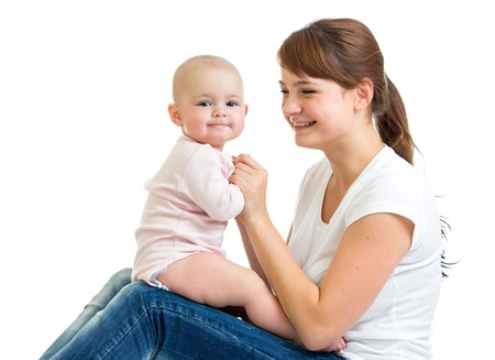 mom holding baby: Loving mother having fun with her baby toddler