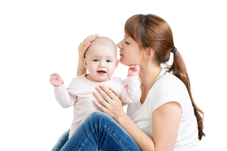happy mother kissing her baby girl Stock Photo - 15644986