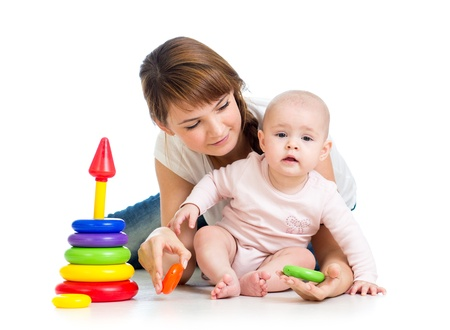 babies with toys: baby girl and mother playing together with construction set toy Stock Photo