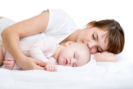 Young mother and her baby sleeping together photo