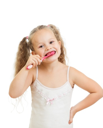 child girl cleaning teeth isolated on white background photo