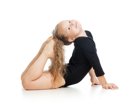Young girl doing gymnastics photo