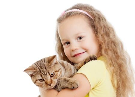 british girl: happy child girl holding  cat isolated on white Stock Photo