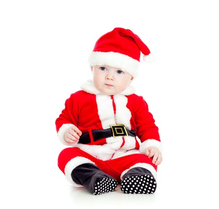 funny little kid in Santa claus clothes photo