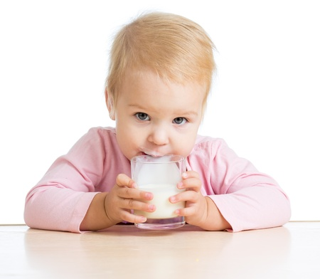 baby drinking yogurt or kefir over white photo