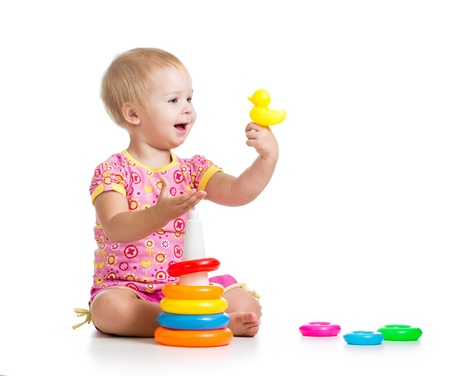 kid girl playing with toy isolated on white background photo