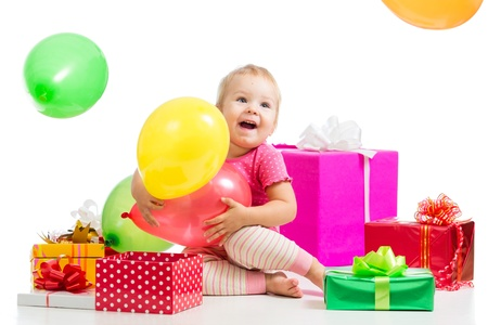 Happy kid girl with colorful balloons and gifts  Isolated on white  photo