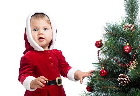 pretty Santa Claus baby decorating Christmas tree isolated on white photo