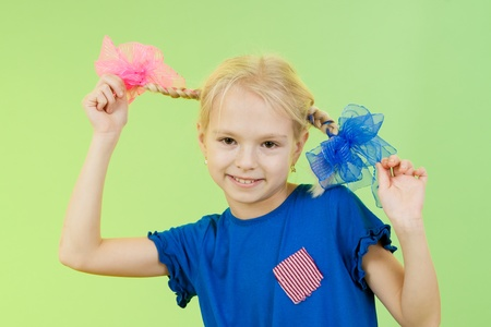 pigtails: pretty girl in bright clothing or fancy dress