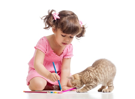 cats playing: painting child girl with playful kitten