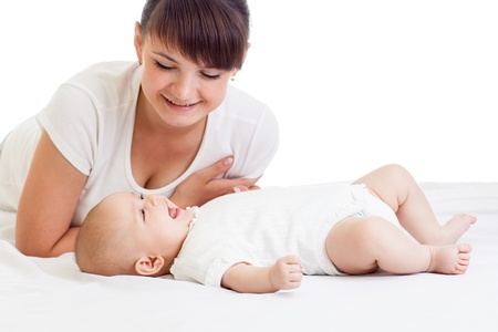 joyful mother looking at her baby infant girl Stock Photo - 15891499