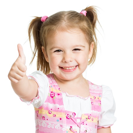 little girl smiling: happy child girl with hands thumbs up Stock Photo