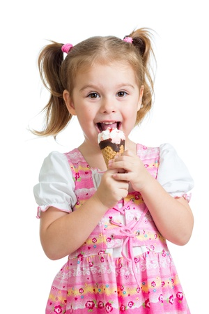 joyful child girl eating ice cream in studio isolated Stock Photo - 15971640