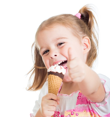 face cream: happy kid girl eating ice cream and showing thumb up Stock Photo