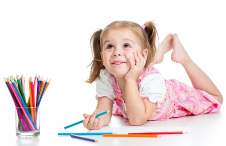 kids dress: dreamy child girl with pencils