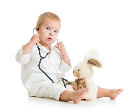 Adorable child with clothes of doctor isolated on white Stock Photo - 15971698
