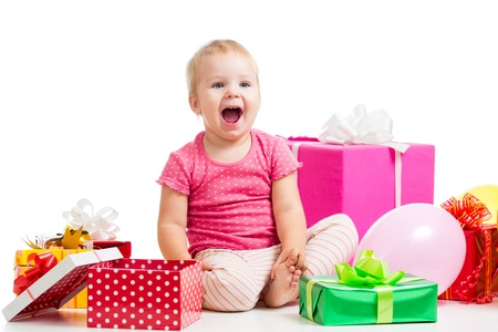 Joyful kid girl with colorful gifts  Isolated on white  photo
