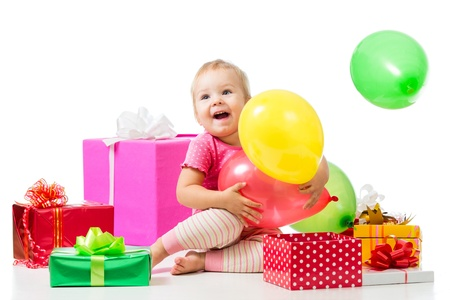 Joyful child girl with colorful balloons and gifts  Isolated on white  photo