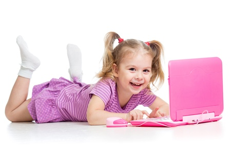 happy child girl playing with laptop toy Stock Photo - 15971784