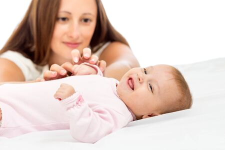 joyful mother playing with her baby infant Stock Photo - 15971739