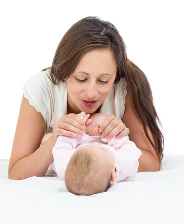 happy mother playing with her baby infant photo