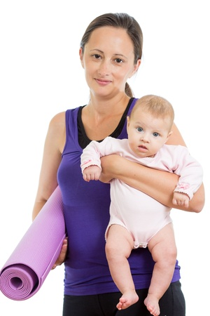 relaxation exercise: Mother going to do fitness exercises with her baby