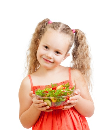 girl kid with healthy food vegetables photo
