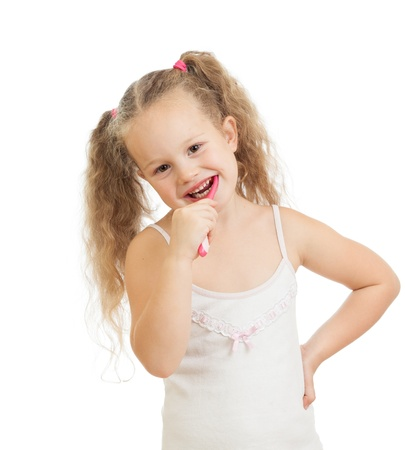 child girl cleaning teeth and smiling, isolated on white background photo