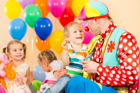birthday party kids: happy children and clown on birthday party