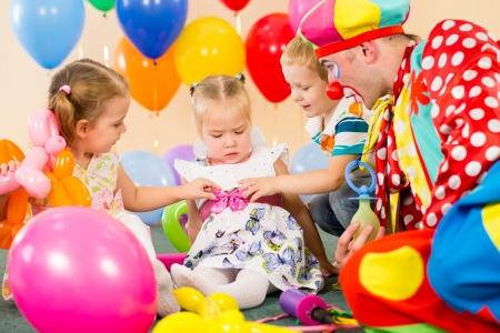 children and clown on birthday party photo