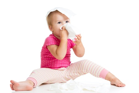 running nose: kid cleaning nose with tissue isolated on white Stock Photo