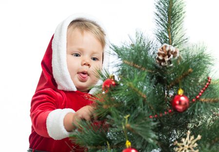 pretty Santa Claus baby decorating Christmas tree isolated on white Stock Photo - 16143351