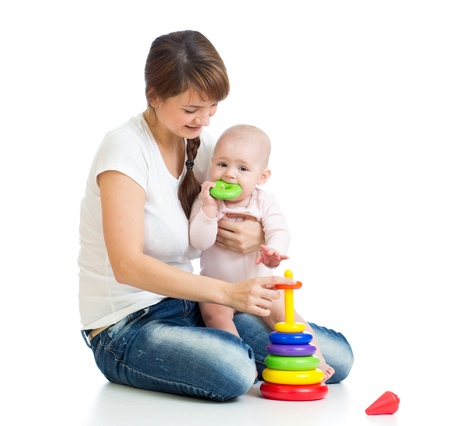 cute mother playing with baby girl photo
