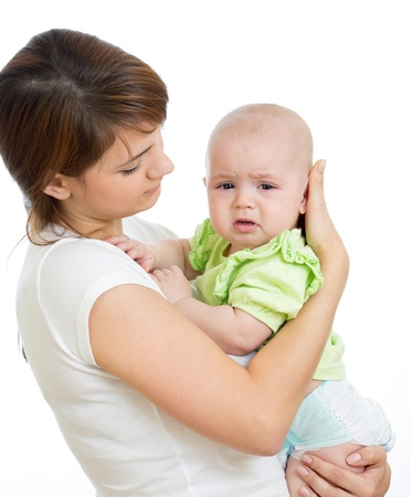 Mother trying to comfort her crying baby isolated photo