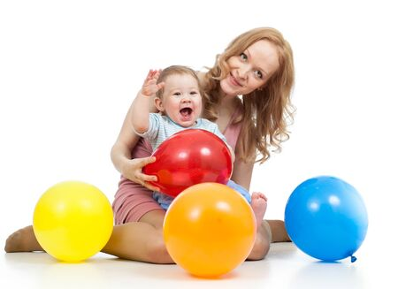 laps: cute mother and baby having fun Stock Photo