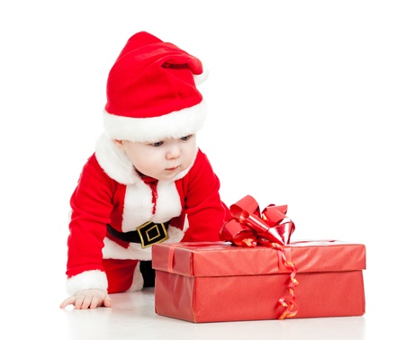 Santa Claus baby boy with gift box isolated on white background photo