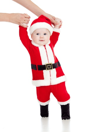 first steps of funny Santa claus baby Stock Photo - 16143390