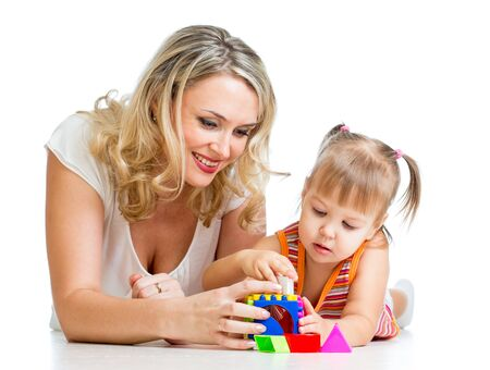 child girl and mother playing together with puzzle toy Stock Photo - 16241700