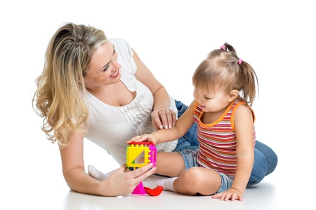 mother and child: child girl and mother playing together with puzzle toy