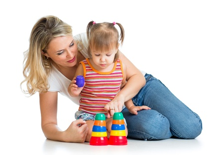 kid girl and mother playing together with cup toys Stock Photo - 16241738