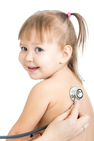 Pediatric doctor examining little baby girl with stethoscope isolated on white photo