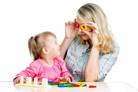 mother and her child fun games with colorful toy photo
