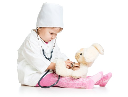 doctor s smock: Adorable child with clothes of doctor and hare toy over white Stock Photo